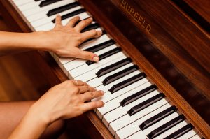 close-up-photo-of-person-playing-piano-1246437